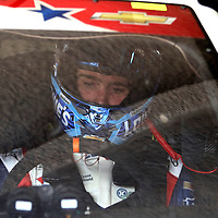Sprint Cup Series driver Jimmie Johnson (48)  sits in his car during the 57th Annual NASCAR Coke Zero 400 practice session at Daytona International Speedway on Friday, July 3, 2015 in Daytona Beach, Florida.  (AP Photo/Alex Menendez)