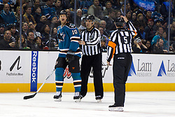 Dec 3, 2011; San Jose, CA, USA; San Jose Sharks left wing Brad Winchester (10) argues with NHL referee Chris Rooney (5) after being called for a penalty against the Florida Panthers during the third period at HP Pavilion. Florida defeated San Jose 5-3. Mandatory Credit: Jason O. Watson-US PRESSWIRE