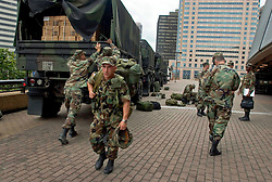 28th August, 2005. Hurricane Katrina, New Orleans, Louisiana. <br /> Shelter of last resort. Members of the Louisiana National Guard prepare to take charge as thousands of desperate people queue to get into the Superdome on the eve of Hurricane Katrina.<br /> Photo Credit: Charlie Varley/varleypix.com