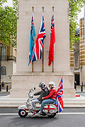 A veteran Mod and his partner take their patriotic scooter for a spin around Westminster and past the Cenotaph - VE Day is remembered on its 75th anniversary.