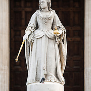 A statue of Queen Victoria outside the main entrance to St Paul's Cathedral in London.