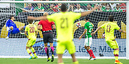Mexican goalkeeper Jesus Corona, left, watches how a perfect volley gets buried to the back of the net as Venezuela celebrates its first goal of the game during the first half of group stage matchup for the Copa America Centenario at NRG Stadium in Houston, Texas on Monday June 13, 2016.