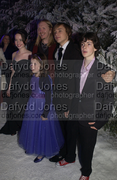"""Anna Popplewell,Andrew Adamson, William Moseley; Georgie Henley;  Skandar Keynes below,and Anna Popplewell. Royal Film Performance and World Premiere of """"The Chronicles Of Narnia"""" at the Royal Albert Hall. London and after-party in Kensington Gardens. 7 December  2005.ONE TIME USE ONLY - DO NOT ARCHIVE  © Copyright Photograph by Dafydd Jones 66 Stockwell Park Rd. London SW9 0DA Tel 020 7733 0108 www.dafjones.com"""