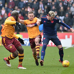 Cedric Kipre (Motherwell) and Allan Campbell (Motherwell) and Kyle Lafferty (Hearts) during the Scottish Cup quarter final between Motherwell and Hearts at Fir Park, where the home side made it into the semi final draw with a win.<br /> <br /> (c) Dave Johnston | sportPix.org.uk