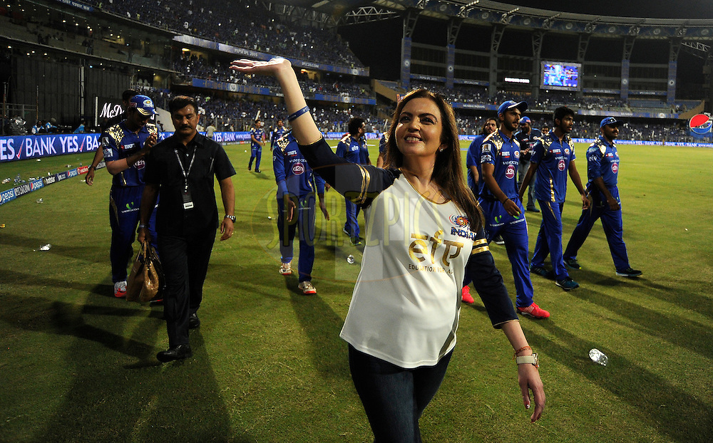 Nita Ambani owner of  Team Mumbai Indians wave to the kids from the NGO education For All (EFA) an initiative from Mumbai Indians after match 23 of the Pepsi IPL 2015 (Indian Premier League) between The Mumbai Indians and The Sunrisers Hyferabad held at the Wankhede Stadium in Mumbai India on the 25th April 2015.<br /> <br /> Photo by:  Pal Pillai / SPORTZPICS / IPL