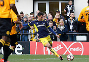 Oxford United midfielder Marvin Johnson (28) has a shot on goal during the FA Cup match between Merstham and Oxford United at Moatside, Merstham, United Kingdom on 5 November 2016. Photo by Andy Walter.