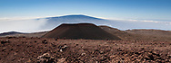 View from the rim of the small crater at the summit of Mauna Kea across a smaller cratered cone toward Mauna Loa in the far distance.  The Mauna Kea Summit Trail is in the foreground. Big Island, Hawaii, © 2010 David A. Ponton