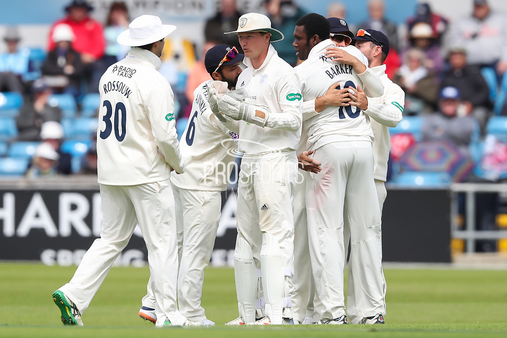 Wicket! Keith Barker of Hampshire celebrates taking the wicket of Adam Lyth of Yorkshire during the opening day of the Specsavers County Champ Div 1 match between Yorkshire County Cricket Club and Hampshire County Cricket Club at Headingley Stadium, Headingley, United Kingdom on 27 May 2019.