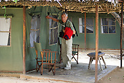 Tanzania wildlife safari European tourist at a lodge