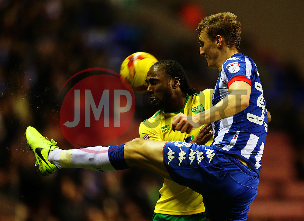 Cameron Jerome of Norwich City challenges Dan Burn of Wigan Athletic - Mandatory by-line: Matt McNulty/JMP - 07/02/2017 - FOOTBALL - DW Stadium - Wigan, England - Wigan Athletic v Norwich City - Sky Bet Championship