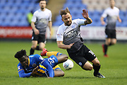 22 Aristote Nsiala for Shrewsbury Town tackles 10 Danny Lloyd for Peterborough United  during the EFL Sky Bet League 1 match between Shrewsbury Town and Peterborough United at Greenhous Meadow, Shrewsbury, England on 24 April 2018. Picture by Graham Holt.