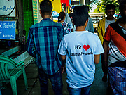 30 NOVEMBER 2017 - YANGON, MYANMAR: A man wearing a pope tee shirt walks down a Yangon street after the Papal Mass at St. Mary's Cathedral in Yangon. Thursday's mass was his last public appearance in Myanmar. From Myanmar the Pope went on to neighboring Bangladesh.    PHOTO BY JACK KURTZ