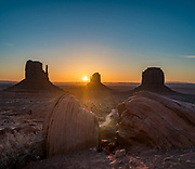 West & East Mittens and Merrick Butte at sunrise in Monument Valley Navajo Tribal Park, Arizona, USA. The Western movie director John Ford set several popular films here. This image was stitched from multiple overlapping photos.