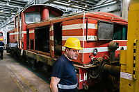 GIOIA TAURO, ITALY - 13 JUNE 2018: A worker is seen here by locomotives under maintenance at Gruppo Ventura,  a family-owned company that installs railroad tracks and does locomotives maintenance,  in Gioia Tauro, Italy, on June 13th 2018.<br /> <br /> Alessandro Ventura, CFO of Gruppo Ventura, traveled there some 20 times over the last three years, establishing a venture with an Iranian company engaged in expanding the national rail network. In March 2017, he signed a 2 million euro contract (about $2.3 million) to service a section of rail outside Teheran.<br /> He shipped two locomotives used to tamp down the rocks below railroad tracks. They went out on a freighter from Gioia Tauro, a port on the Tyrrhenian Sea that has long been notorious as a Mafia-run conduit for cocaine trafficking.<br /> Last August, Mr. Ventura stood at the Iranian port of Bandar Abbas in 122 degree heat, watching a crane hoist the locomotives onto the docks.<br /> Now, those machines are effectively marooned, the business halted. Gruppo Ventura has lost appetite for adventurous expansion.<br /> <br /> Once the Obama administration struck the nuclear deal with Iran three years ago, Italy saw a chance. Last year, Italy exported more than 1.7 billion euros (nearly $2 billion) worth of goods to Iran. Then, President Trump withdrew the United States from the Iran deal and vowed to reinstate sanctions, dealing a blow to companies across Europe — especially those from Italy, Germany and France.