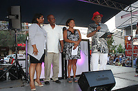"""The Harper Court Summer Concert Series kicked off Wednesday with a celebration honoring Chicago Radio Host Herb Kent. Harper Court was filled with people dancing and learning to Step while Chicago D.J.'s played music. <br /> <br /> 7702 – D. J. Cadillac Seth Williams accepted the key to Hyde Park for Herb Kent as he was unable to attend the event.<br /> <br /> (l to r) - Assistant Principle for Hyde Park High School, Stephanie Glover Douglas, Executive Director for the Hyde Park Chamber of Commerce, Wallace Goode, Executive Director for the South East Chicago Commission, Wendy Walker Williams, D. J. Cadillac Seth Williams <br /> <br /> <br /> Please 'Like' """"Spencer Bibbs Photography"""" on Facebook.<br /> <br /> All rights to this photo are owned by Spencer Bibbs of Spencer Bibbs Photography and may only be used in any way shape or form, whole or in part with written permission by the owner of the photo, Spencer Bibbs.<br /> <br /> For all of your photography needs, please contact Spencer Bibbs at 773-895-4744. I can also be reached in the following ways:<br /> <br /> Website – www.spbdigitalconcepts.photoshelter.com<br /> <br /> Text - Text """"Spencer Bibbs"""" to 72727<br /> <br /> Email – spencerbibbsphotography@yahoo.com"""