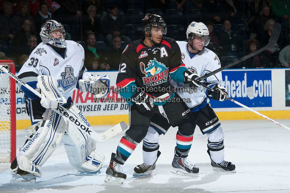 KELOWNA, CANADA - NOVEMBER 20:  Tyrell Goulbourne #12 of the Kelowna Rockets looks for the pass in front of Patrik Polivka #33 of the Victoria Royals on November 20, 2013 at Prospera Place in Kelowna, British Columbia, Canada.   (Photo by Marissa Baecker/Shoot the Breeze)  ***  Local Caption  ***