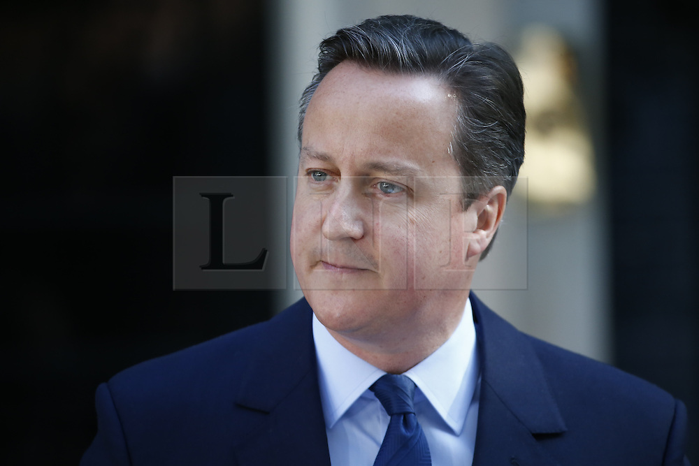 © Licensed to London News Pictures. 24/06/2016. London, UK. Prime Minister DAVID CAMERON announces the EU referendum results in Downing Street, London on Friday, 24 June 2016. The UK has voted by a narrow margin to leave the European Union. Photo credit: Tolga Akmen/LNP