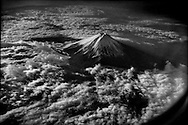Mt. Fuji, Japan's highest mountain (3,776m / 12388 ft) and the symbol of the nation is an active volcano.  Mt. Fuji sits 100 km away from the Tokyo metropolitan area megapolis of 30 million people.  It is also about due to erupt, as it last erupted in 1707.  Retired Ryukyu University professor Masaki Kimura believes it should haver erupted in 2011 (with a four-year margin of error) because the pressure in the magma chamber is believed to be higher than it was when it last erupted over 400 years ago, which was triggered by a massive earthquake in Osaka.  Many believe that the massive earthquake in 2011 could be such a trigger.<br /> <br /> An eruption of Mt. Fuji, a committee of experts believe the worst damage would be to the city of Shizuoka at the base of the mountan and 580,000 people would need to evacuate due to lava and pyroclastic flows, TV Asahi reported early in 2014.  Volcanic ash could be carried to the Tokyo metropolitan area affecting air, rail and roads, and highways.  <br /> <br /> More worrisome, Professor Kimura says that magma is rising and cracks in the earth have been growing.  The water level in Lake Sai, at the volcanoes base rose by a meter after the Tohoku earthquake and tsunami, suggesting he says that the rising magma is melting Fuji's permafrost, which finds its way to the lake.