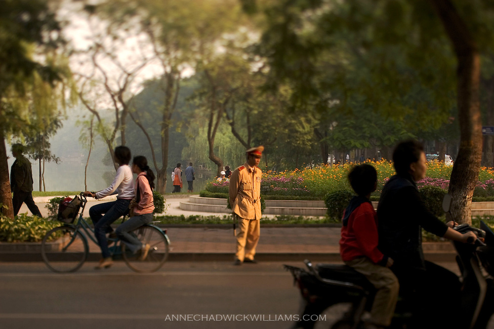 Hanoi, Vietnam police officer monitors morning traffic.