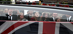 © under license to London News Pictures.  25/11/10..(Left to right, starting with lady in red coat, confirmed by a visiting army officer) The girlfriend, sister, and mother of Guardsman Christopher Davies the 100th soldier to die in Afghanistan, await his body in Wootton Bassett. Guardsman Davies of 1st Battalion Irish Guards was killed while taking part in a security patrol in Nahr-e Saraj (North), Helmand province on November 17. ..Picture credit should read: Rebecca Mckevitt/London News Pictures