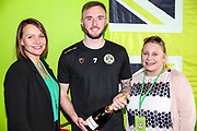 Match sponsor First Base present Forest Green Rovers Carl Winchester(7) with MOM award during the EFL Sky Bet League 2 match between Forest Green Rovers and Macclesfield Town at the New Lawn, Forest Green, United Kingdom on 13 April 2019.