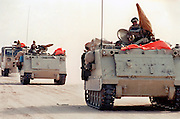 A Qatar coalition forces armor column rolls through the desert as they join in the liberation of Kuwait from Iraqi occupation February 26, 1991 in Kuwait City, Kuwait.