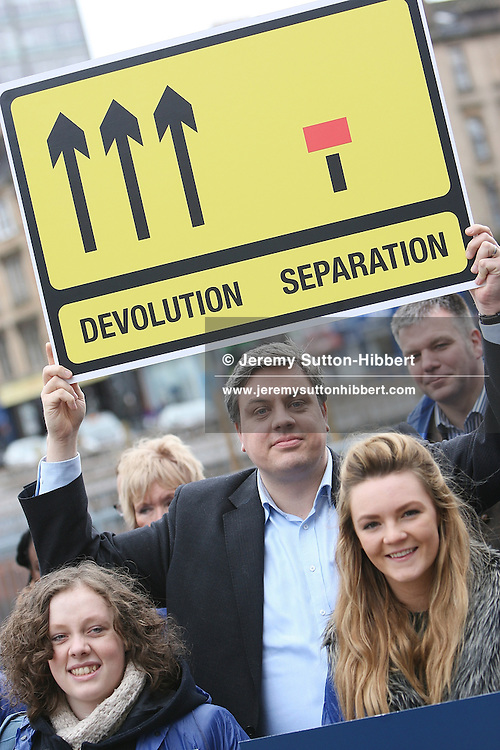 GLASGOW, SCOTLAND - MARCH 18:  Better Together campaign leader Blair McDougall (centre) holds aloft a campaign sign supporting devolution rather than separation, as activists gather to stage a photocall to mark the '6-months to go' date until the Scottish independence referendum, on March 18, 2014 in Glasgow, Scotland. A referendum on whether Scotland should be an independent country from the United Kingdom will take place on September 18, 2014.  (Photo by Jeremy Sutton-Hibbert/Getty Images)