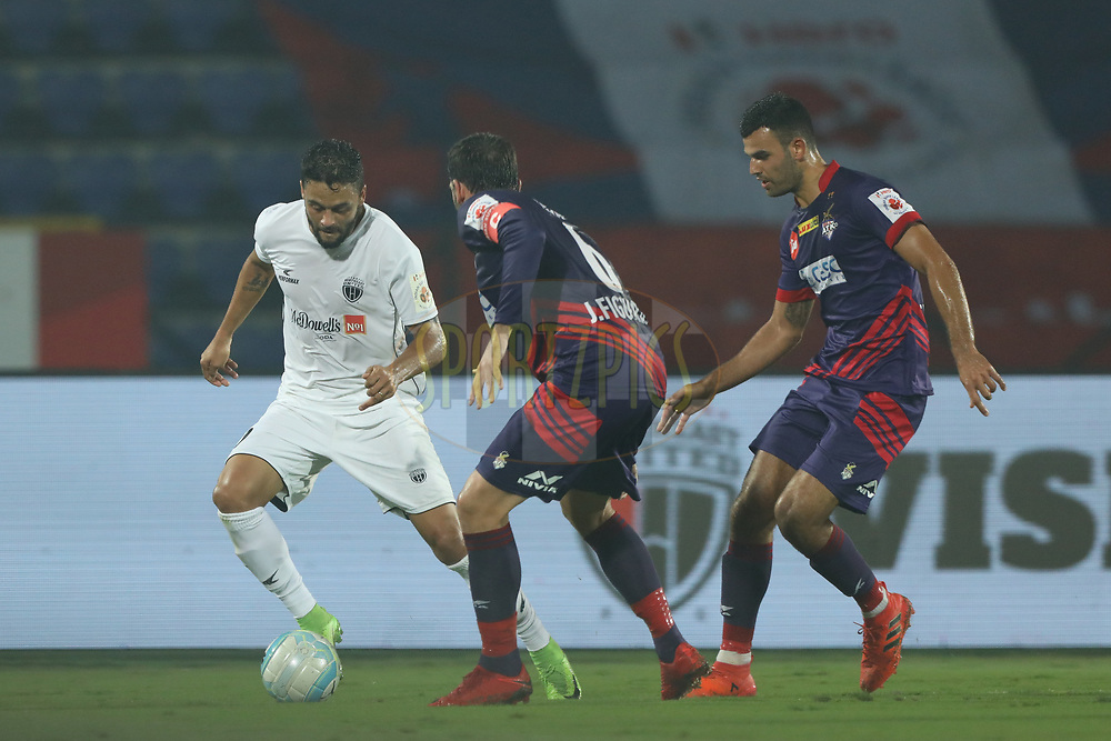 Marcio de Souza Gregorio Junior of Northeast United FC   fight for ball during match 45 of the Hero Indian Super League between NorthEast United FC and ATK  held at the Indira Gandhi Athletic Stadium, Guwahati India on the 12th January 2018<br /> <br /> Photo by: Arjun Singh  / ISL / SPORTZPICS