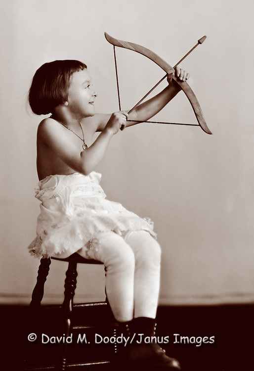 Little girl as cupid with bow and arrow, circa 1900