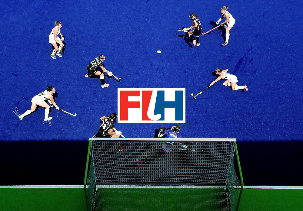 New Zealand's Petrea Webster (R) takes a shot at goal during the women's Bronze medal hockey match between Germany and New Zealand of the Rio 2016 Olympic Games at the Olympic Hockey Centre in Rio de Janeiro on August 19, 2016. / AFP / MANAN VATSYAYANA        (Photo credit should read MANAN VATSYAYANA/AFP/Getty Images)