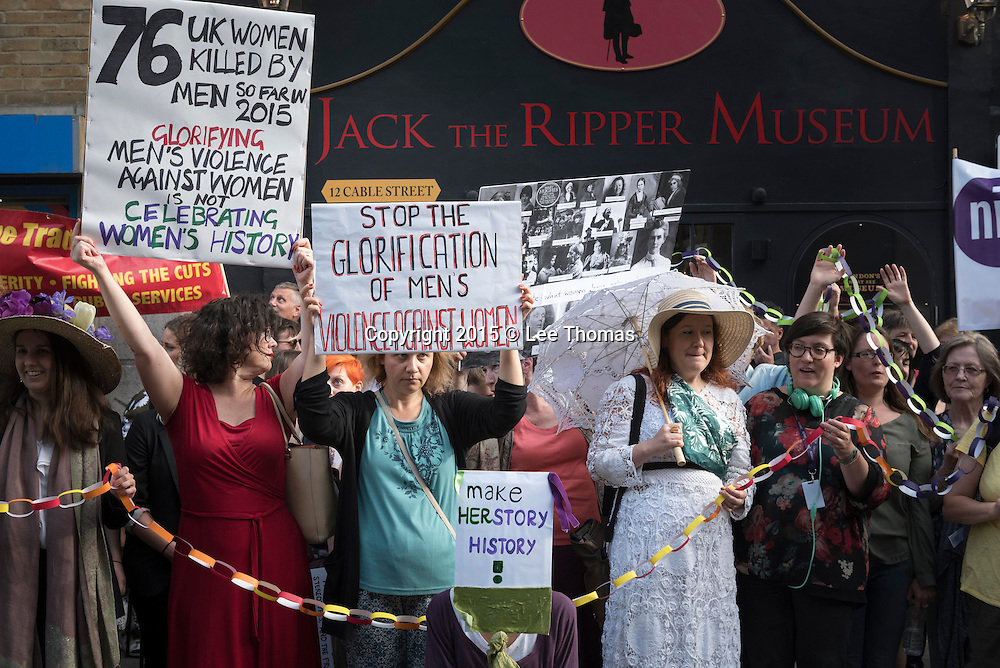 Jack the Ripper Museum, 12 Cable Street, London, E1 8JG, UK. 4th August, 2015. Local residents together with backing from the Emily Wilding Davison Memorial Campaign and other interested groups, stage a protest outside the Jack the Ripper Museum on Cable Street in East London. The demonstration coincided with the opening night of the new venue which was originally proposed as a museum celebrating women's history. The protesters claim the museum dedicated to the infamous murderer of prostitutes denigrates the history of struggle for women's rights, a struggle that was particularly vibrant and pioneering in East London. Pictured:  Protesters, some dressed as Suffragette s, stand in front of the museum.  // Lee Thomas, Flat 47a Park East Building, Bow Quarter, London, E3 2UT. Tel. 07784142973. Email: leepthomas@gmail.com. www.leept.co.uk (0000635435)