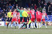 referee Dean Whitestone is surrounded as he blows the whistle for half time Accrington players think its for a goal during the Sky Bet League 2 match between AFC Wimbledon and Accrington Stanley at the Cherry Red Records Stadium, Kingston, England on 5 March 2016. Photo by Stuart Butcher.