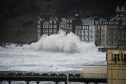 "© London News Pictures. 08/02/2014. Aberystwyth, UK. <br /> Gale force winds and giant waves strike the sea walls at Aberystwyth, Wales at high tide. The winds are forecast to strengthen throughout the day, gusting up to 70 or 80 mph, and with the rising tide, their impact could be potentially damaging again. An amber ""be prepared"" warning  has been issued by the Met Office for wind,. Photo credit: Keith Morris/LNP"