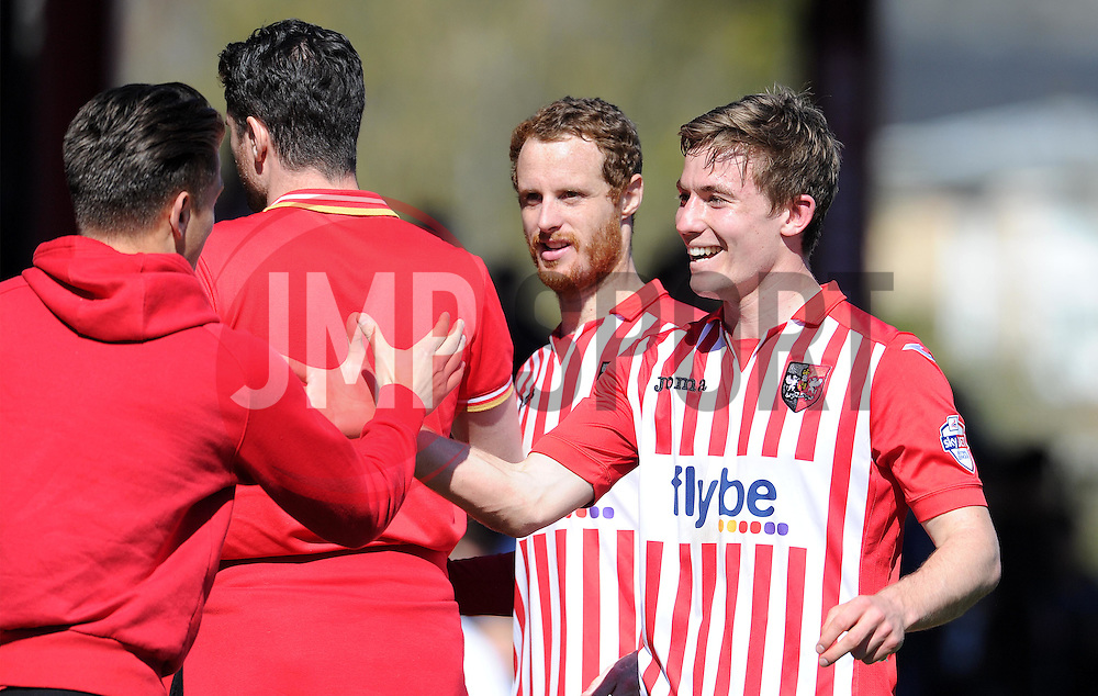 Exeter City's David Wheeler and Exeter City's Ryan Harley celebrate victory - Photo mandatory by-line: Harry Trump/JMP - Mobile: 07966 386802 - 06/04/15 - SPORT - FOOTBALL - Sky Bet League Two - Exeter City v Newport County - St James Park, Exeter, England.