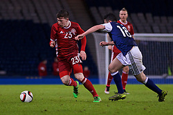 GLASGOW, SCOTLAND - Tuesday, March 29, 2016: Denmark's Pierre Emile Højbjerg in action against Scotland's John McGinn during the friendly game at Hampden Park. (Pic by Lexie Lin/Propaganda)