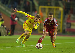 BRUSSELS, BELGIUM - Sunday, November 16, 2014: Wales' George Williams in action against Belgium's Eden Hazard during the UEFA Euro 2016 Qualifying Group B game at the King Baudouin [Heysel] Stadium. (Pic by David Rawcliffe/Propaganda)