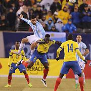Ezequiel Garay, Argentina, wins a header from Felipe Caicedo, Ecuador, during the Argentina Vs Ecuador International friendly football match at MetLife Stadium, New Jersey. USA. 31st march 2015. Photo Tim Clayton