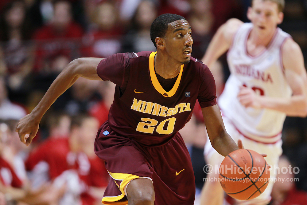 Jan. 12, 2012; Bloomington, IN, USA; Minnesota Golden Gophers guard Austin Hollins (20) brings the ball up court against the Indiana Hoosiers at Assembly Hall. Minnesota defeated Indiana 77-74. Mandatory credit: Michael Hickey-US PRESSWIRE