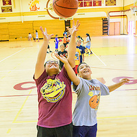 061015  Adron Gardner/Independent<br /> <br /> Kinley Tom, left, and Miguel Hernandez compete for a rebound during basketball camp at Tohatchi High School Wednesday.