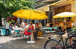 Busy cafe Bodvar in summer in Prenzlauer Berg in Berlin, Germany