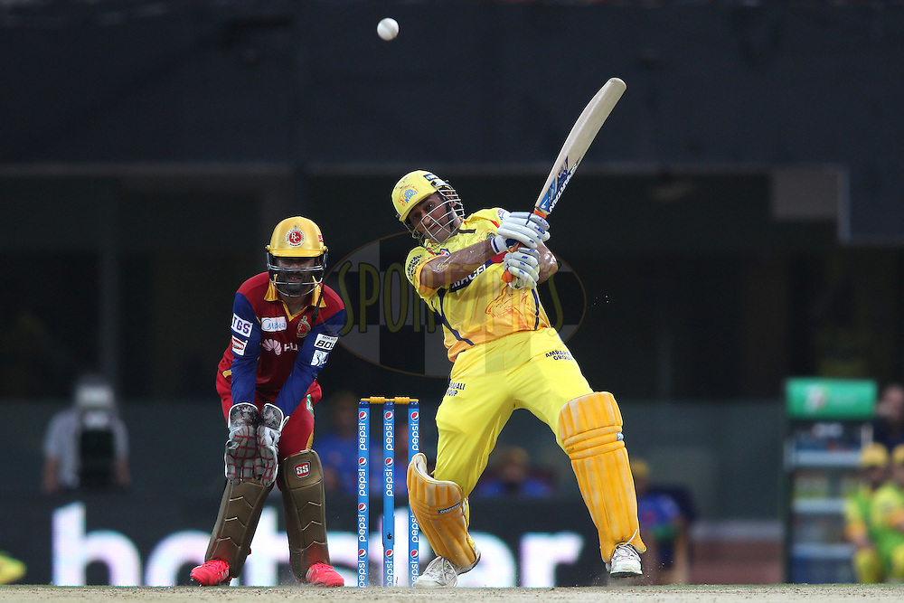 Chennai Super Kings Captain MS Dhoni hits over the top and is caught by Mitchell Starc of the Royal Challengers Bangalore during match 37 of the Pepsi IPL 2015 (Indian Premier League) between The Chennai Superkings and The Royal Challengers Bangalore held at the M. A. Chidambaram Stadium, Chennai Stadium in Chennai, India on the 4th May April 2015.<br /> <br /> Photo by:  Shaun Roy / SPORTZPICS / IPL