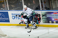 KELOWNA, CANADA - OCTOBER 10:  Loeden Schaufler #32 of the Seattle Thunderbirds checks Kyle Topping #24 of the Kelowna Rockets into the boards behind the net on October 10, 2018 at Prospera Place in Kelowna, British Columbia, Canada.  (Photo by Marissa Baecker/Shoot the Breeze)  *** Local Caption ***