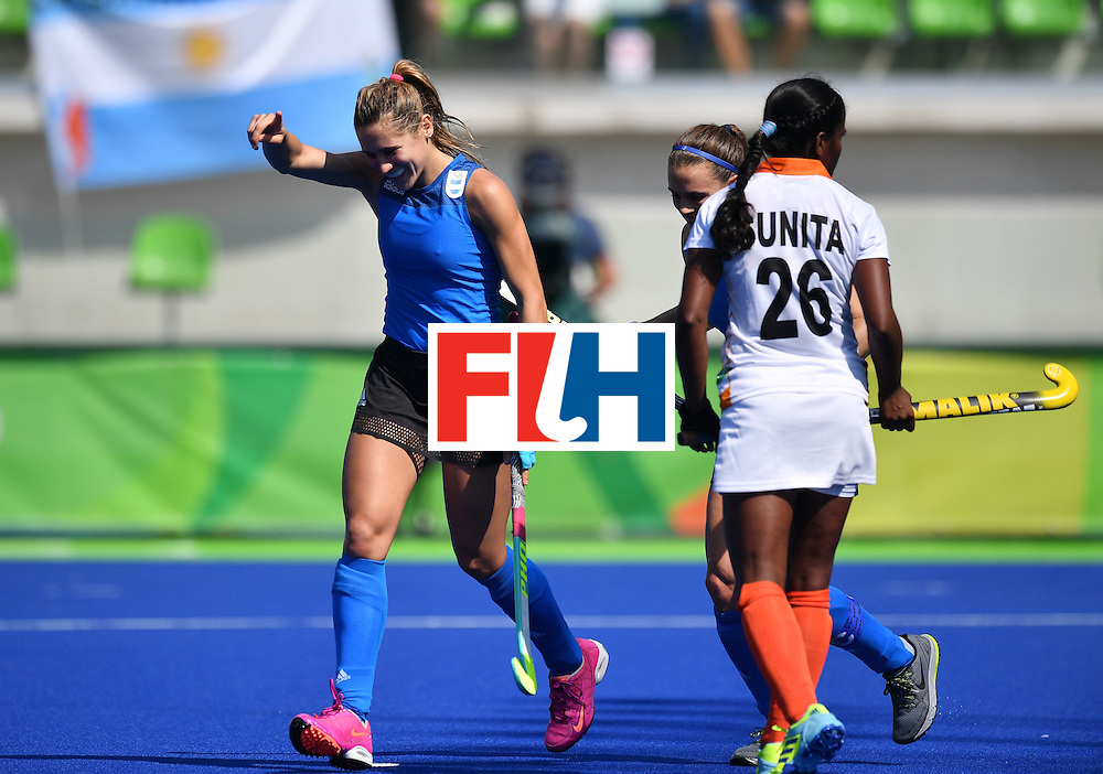 Argentina's Martina Cavallero (L) celebrates scoring during the women's field hockey Argentina vs India match of the Rio 2016 Olympics Games at the Olympic Hockey Centre in Rio de Janeiro on August, 13 2016. / AFP / Carl DE SOUZA        (Photo credit should read CARL DE SOUZA/AFP/Getty Images)