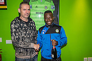 Forest Green Rovers Drissa Traoré(4) receives his man of the match award from chairman Dale Vince during the Vanarama National League match between Forest Green Rovers and Tranmere Rovers at the New Lawn, Forest Green, United Kingdom on 22 November 2016. Photo by Shane Healey.