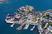Above the Arctic Circle, ascend a slippery steep trail to Reinebringen for views of the town of Reine and Reinefjord, on Moskenesøya (the Moskenes Island), Lofoten archipelago, Nordland county, Norway.