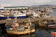 ICE.MWdrv05.04.xrw..View of the boats in the harbor from the Maritime Museum of Reykjavik, Iceland. Margret (Linda) Gunnlaugsdottir, 52, works part time here. Ten years ago she and her family were the Icelandic participants in Material World: A Global Family Portrait, 1994 for which they took all of their possessions out of their house for a family and possessions portrait in the snow. Pages 162-163. {{Central image from original book project is: ICE.mw.01.xxs.}}.