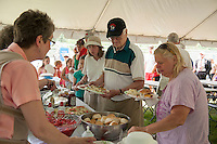 Kiwanians and guests enjoy a complimentary BBQ following the 70th Anniversary celebration of the Kiwanis Pool in St. Johnsbury Vermont.  Karen Bobotas / for Kiwanis International