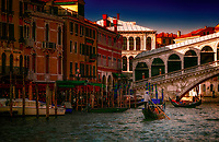 """Evening sun highlights the Gondolas under the Rialto Bridge in Venice""…<br />