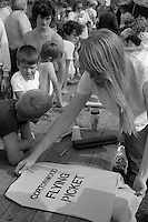 Community arts workers silkscreening  clothing with support slogans. Cortonwood Gala Day. Brampton Brierlow 25/08/1984.
