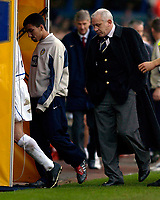 Photo. Jed Wee.<br /> Leeds United v Arsenal, FA Barclaycard Premiership, Elland Road, Leeds. 01/11/03.<br /> Leeds manager Peter Reid (R) seeks the refuge of the tunnel as opposite number Arsene Wenger fails to conceal his delight in the background.